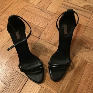 Strapping black leather heels